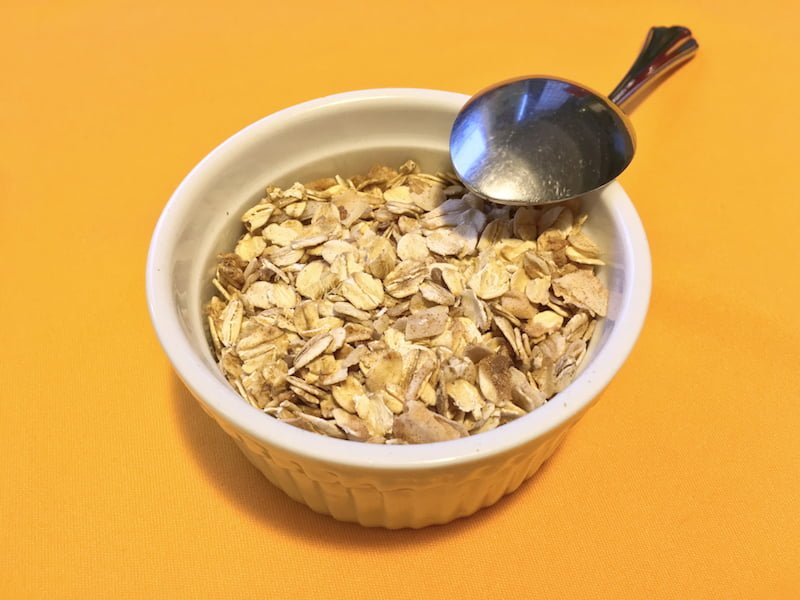 granola in dish with spool